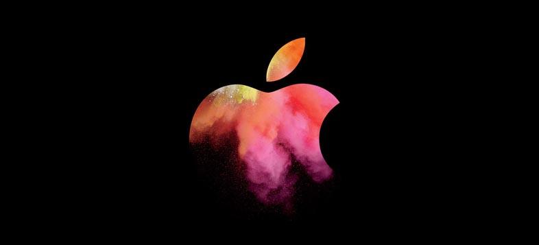 暗闇から浮かび上がるようなアップルロゴ